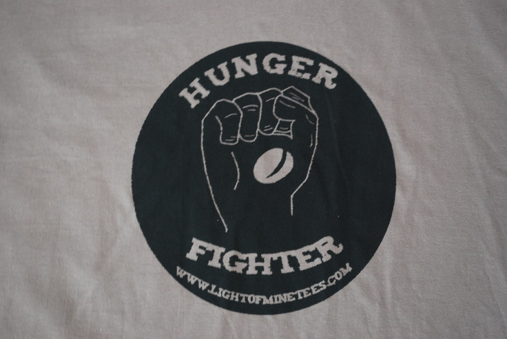 Light of Mine's new Hunger Fighter Tee!  Get yours now!Hunger Fighter, Fighter Tees, Mine Products, Mine Offices