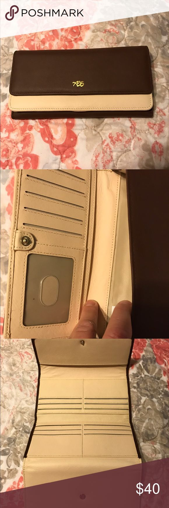 Women's wallet with multiple card slots Brown and tan multiple card slot clutch, always be secure, credit card numbers are protected,was purchased from QVC,still in the box always be secure Bags Wallets