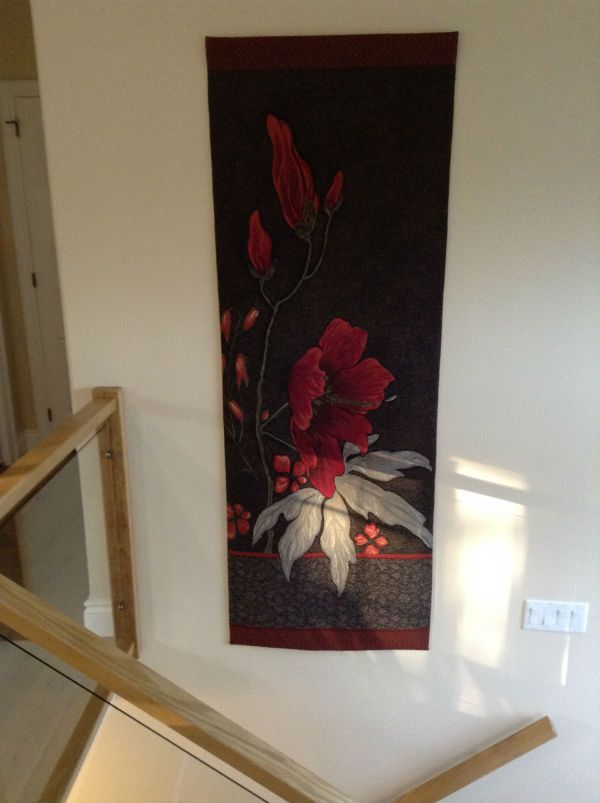 """The richly woven Dark Althea tapestry gives warmth to this staircase making the most of its 78"""" height. A French portiere tapestry in wool and cotton."""