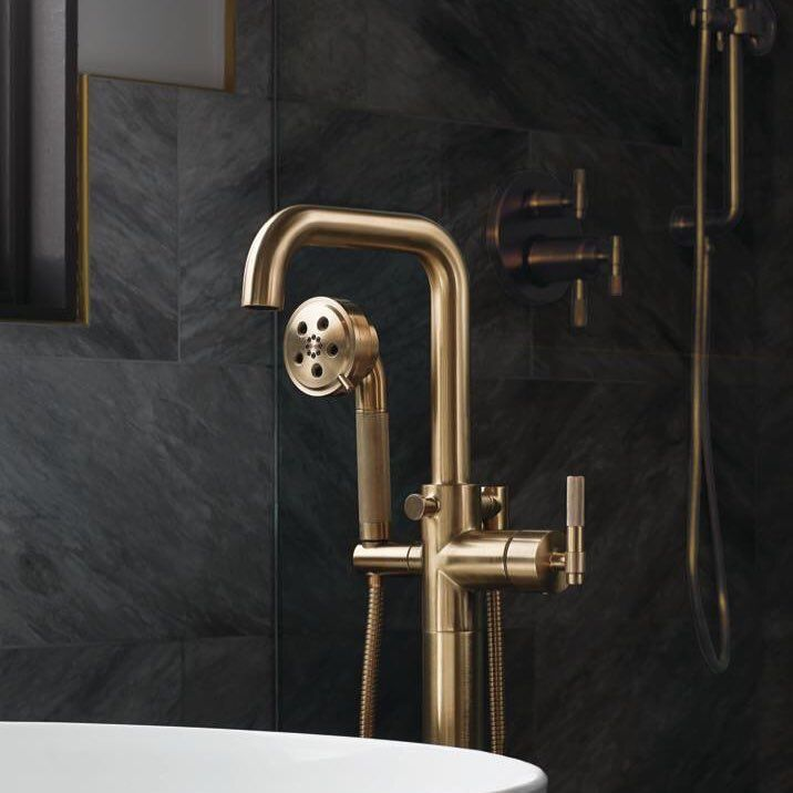 The Simple Yet Intricate Design Of The Litze Tub Filler Creates A Stunning Silhouette Against Sleek Grey Marble In A Tub Faucet Freestanding Tub Faucet Faucet