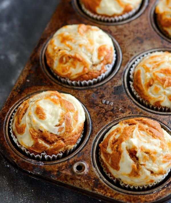 """Pumpkin Cream Cheese Swirl Muffins: moist spiced pumpkin muffins are topped with sweet cream cheese that melts into them as they bake and only take 30 minutes! Pumpkin """"season"""" is quickly coming to a close with it's last big day on Thursday. I am already morning it's loss. I decided I had to end this …"""