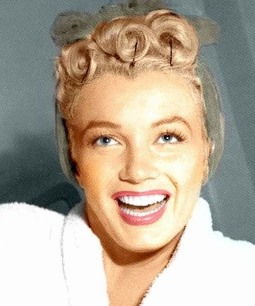 Marilyn with her hair in pin curls, 1950s.