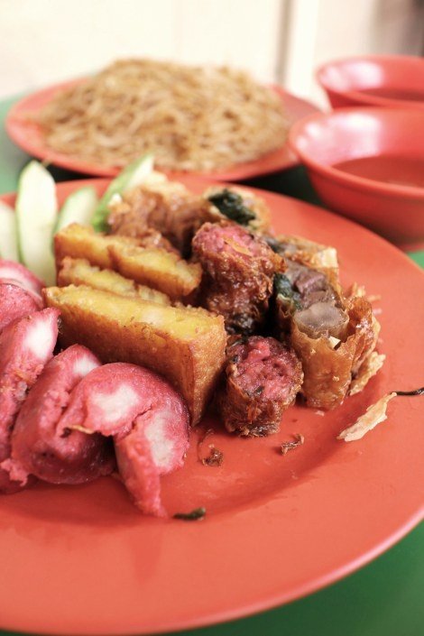 Ngoh Hiang is a unique Hokkien and Teochew dish served in Singapore's food courts and hawker centres where many stalls sell fried bee hoon with ngoh hiang; and is common for breakfast and lunch. It is essentially a composition of various meats and vegetables and other ingredients such as egg slice, liver roll, chinese sausage, etc. Try Hup Kee China Street Ngoh Hiang at Maxwell Food Centre (#01-97). By Taxi: about 15 mins from RP