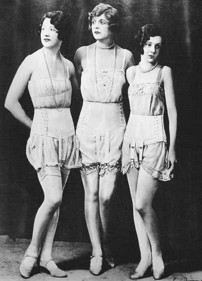 Lingerie of the 1920s. Models flaunt the short girdle garter belt worn over cami-knickers.