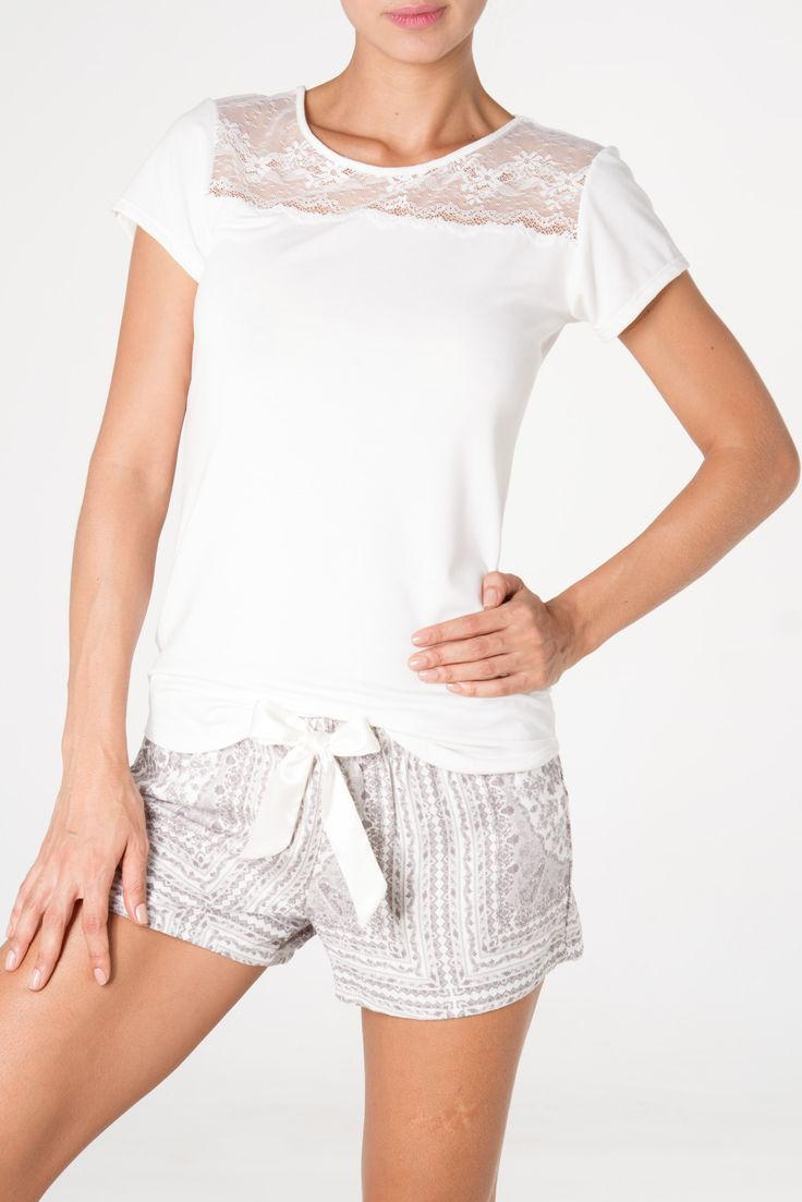 Lace details on the shirt, silk details on the short