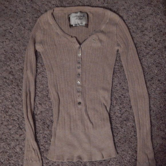 Abercrombie and Fitch button long sleeve shirt Tan stretch shirt with buttons half way down. Very gently worn. Abercrombie & Fitch Tops Button Down Shirts