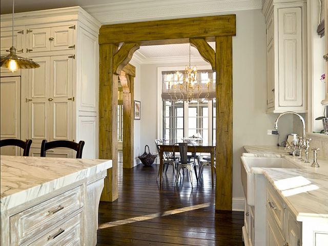 Love this look in the doorway.  I would have lighter wood, but its a great idea.