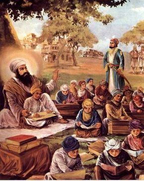 While Guru Angad Dev Ji is absorbed in teaching children..