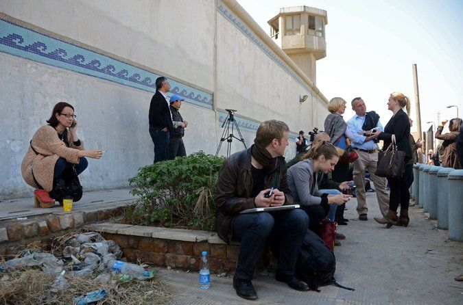 After Egypt extends crackdown to includ journalists, reporters are joined by relatives of three Al Jazeera English journalists waiting outside Tora prison in Cairo for word of what happened to them. (February 2014)