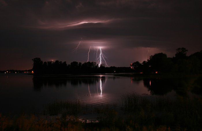 Lightning Across South Center Lake  by Michael Aguirre on Capture Minnesota // Multiple lightning strikes across South Center Lake. This has become an obsession with my photography- I am just obsorbed in the thrill of the capture and the excitement of the chase and challenge.  I don't enjoy the thoughts of the danger, but the danger adds to the excitement and thrill!