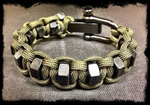 Adjustable paracord hexnut bracelet... Looks complicated, but awesome!