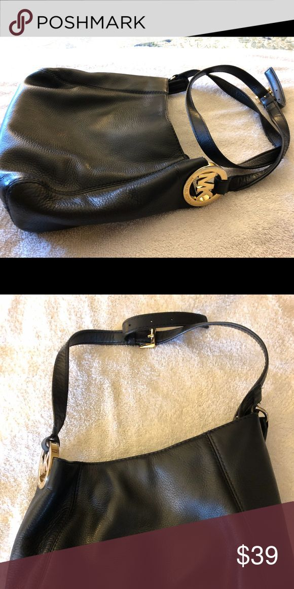 Black leather handbag some signs of wear by threading