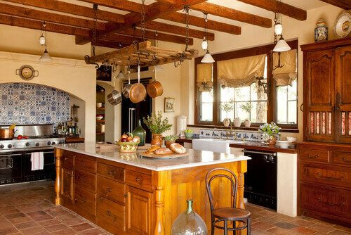 This Mediterranean style kitchen has a lovely tile mosaic backdrop to its stove area. A mosaic is a perfect place to introduce the blues that will symbolize the sky and sea.