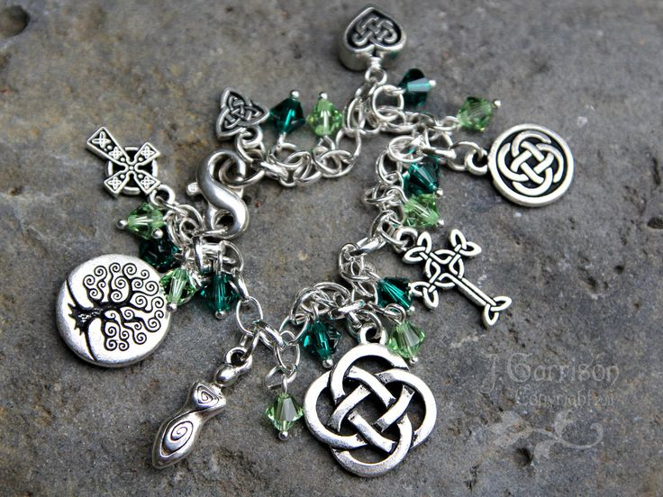 Deluxe Celtic Symbols Silver Charm bracelet with emerald & peridot green…
