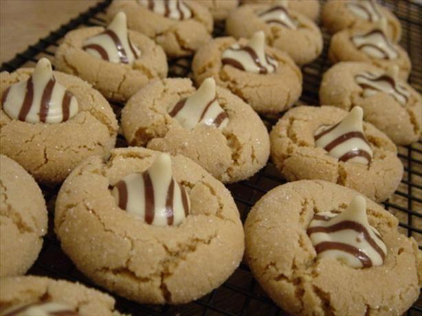 Hershey s Kiss Peanut Butter Cookies  http://www.food.com/recipe/hersheys-kiss-peanut-butter-cookies-191225