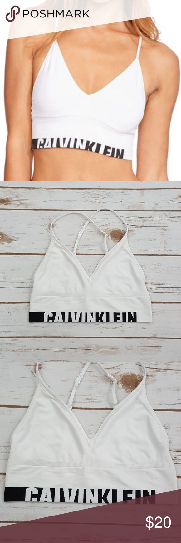 Calvin Klein Seamless Logo Bralette Unlined Calvin Klein Seamless Logo Bralette Unlined Longline Multiway White Sz Sm NWOT No padding, no wire Adjustable shoulder straps Can wear straps regularly or criss-crossed No fastening, goes over the head Calvin Klein logo band Micofiber jersey Upper body: 88% nylon, 12% elastane Lower body: 72% nylon, 22% elastane, 6% polyester Calvin Klein Intimates & Sleepwear Bras