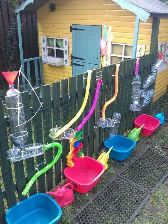 Keep your little ones busy. Great for warmer weather fun. Tack PVC bottles and pipes to a wooden post . Add water, get fun!: