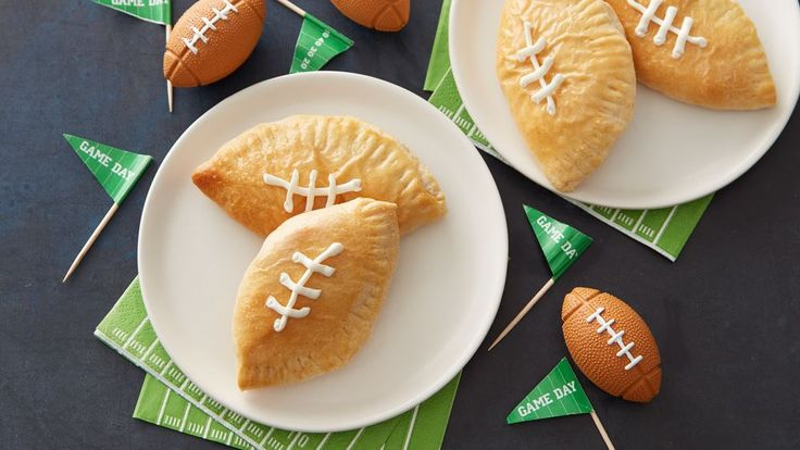 These football calzones are stuffed with everyone's favorite Buffalo chicken, and they're perfect for serving on game day!