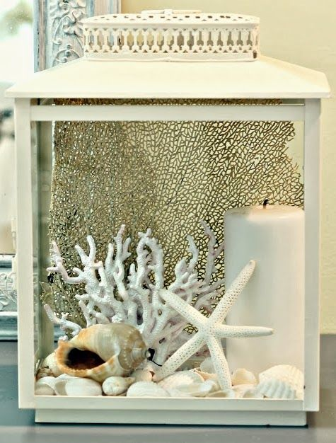 Lanterns make great display cases for sea treasures! Sea all ideas here: http://www.completely-coastal.com/2014/03/beach-lanterns.html