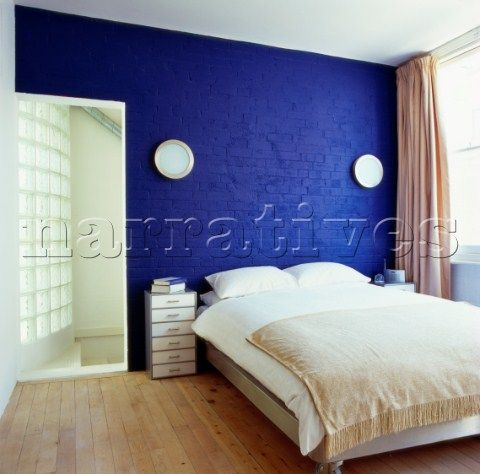 bedroom with cobalt blue painted brick wall client katie