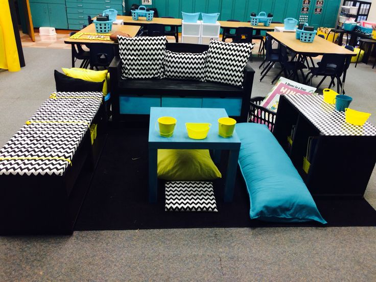 Reading nook in the middle of this kinder room. Space to work for flexible seating too