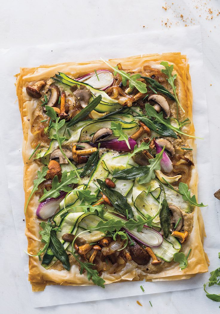 If you're making a savory tart, flaky phyllo dough is a brilliant alternative to a traditional pie crust. The only catch is, most recipes have you brush each layer with melted butter. Using melted coconut oil works just as well; and, in this case, tastes even better. That's because it beautifully complements this tart's toppings, which are much lighter than your typical bacon, ham or cheese.