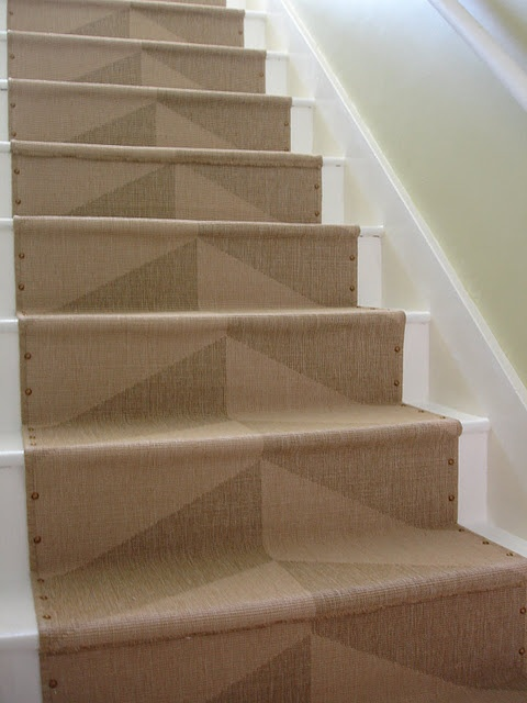 DIY staircase runner! Ikea rug, with added brass nail heads, click picture for step by step instruction!