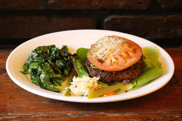 Naked Burger rated top 10 best burger by VegNews #vegnews no bun, sauted dark greens, mushroom burger, lettuce, tomato, and sprouts! #organic #veggie #green #homemade #eastvillage #vegan #nyc #eco #veggieburger #homemadeburger #ogstyle