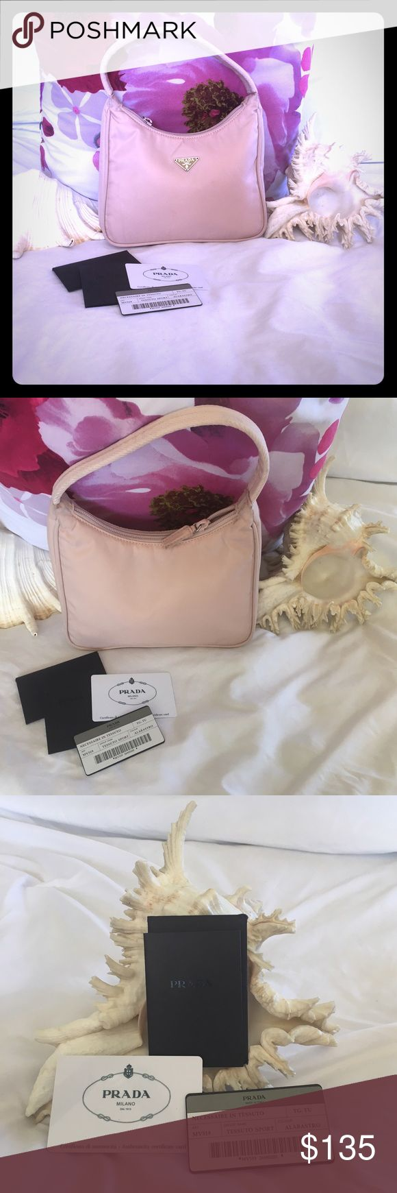 """🆕Listing Authentic Prada Light Pink Purse 👛 Beautiful Prada purse kept in good condition, no rips or wear with authentic certification. Ready to sell with reasonable offer💗💗💗Authenticity Card Included   Country of Make: Italy  Model Number: MV519  Handbag Approx. Measurements: 8""""Length x 2.5""""Depth x 6""""Height Handle Approx. Length: 11""""  Color: Light Pink / Silver Hardware Prada Bags Mini Bags"""