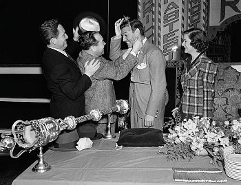 """spencer tracy and eddie mannix crown clark gable """"king of hollywood"""" as myrna loy looks on. (1937, set of """"test Pilot"""", dir. victor fleming)"""
