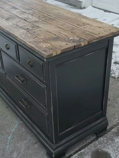 Painted Bassett Dresser - a more formal piece of furniture is given a rustic redo with a distressed black paint finish and a salvaged wood plank top - via Tattered Lantern