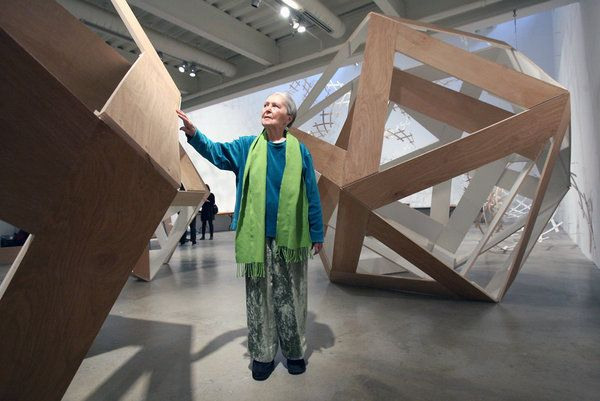 Anne Griswold Tyng looks over one of the Platonic solids at the retrospective of her work.