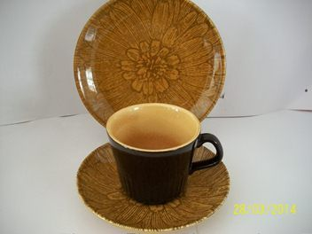 1x Apollo Cup deep Chocolate brown.  1x saucer and side plate (Kelston Sunflower pattern D234)