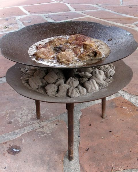 "The ""cowboy wok"" is legendary in South Texas.  The first cowboy woks were made out of used cultivator discs. The discs start out with sharp edges, they get discarded when the edge wears off. I guess somebody got the bright idea that the worn out metal blades would be great for cooking"