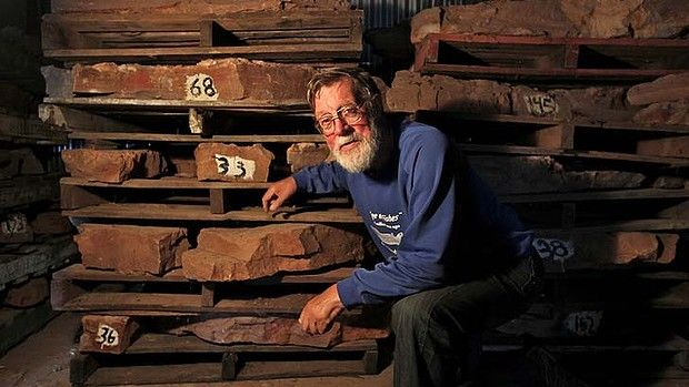 Dr Alex Ritchie, palaeontologist pictured with fossils from the original Canowindra fish fossil site stored under the grandstand at the Canowindra race course  smh news  photos Ben Rushton  January 30 2013