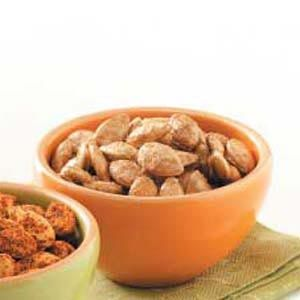 Candied Pumpkin Seeds. 1 c. fresh pumpkin seeds, 1/4 c. brown sugar, 1/2 tsp. pumpkin pie spice, 1/4 tsp. salt. Mix ingredients in bowl. Spread seeds onto greased foil lined baking sheet. Bake at 250 degrees for 45-50 minutes or until well glazed, stirring occasionally.