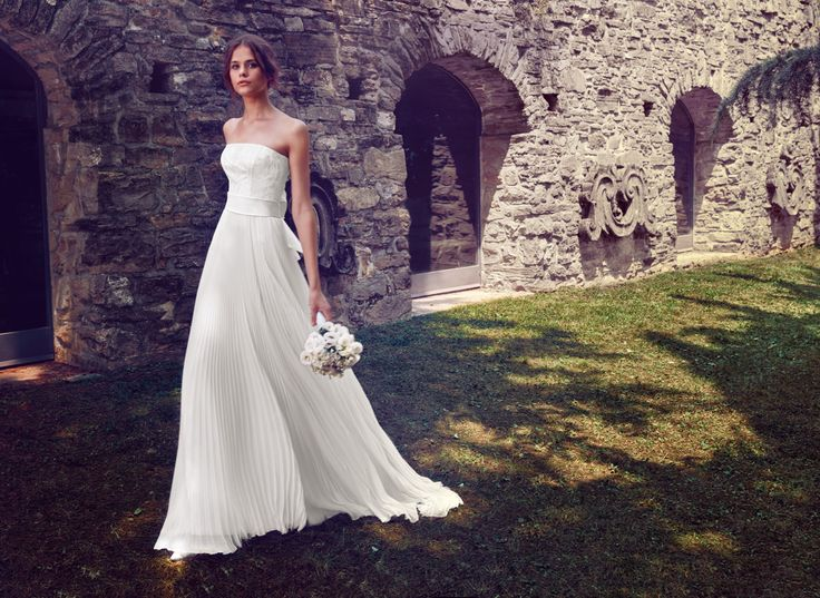 Refined wedding gown with pleated sheath skirt and signature bow on the back. See Giuseppe Papini 2016 bridal collection on www.giuseppepapini.com