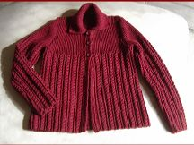 Plus size knitting pattern for a cable and rib jacket.