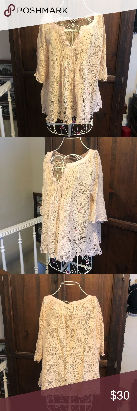 """Antique Style Lace Flowy Top EUC Cute and romantic! Can't help but adore this antique style lace top, size Medium (could easily fit a large also), made by Vintage America. Cream or beige in color, see through, so pair with a nude colored cami or a bright colored one for a fun pop! Super flowy and flattering, measures about 21"""" across the chest laying flat and has some stretch. About 23"""" long from shoulder to hem. Cute v neck cut out at the neckline and 3/4 length flowy sleeves. Vintage…"""