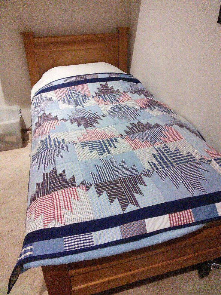 Bonnie Hunter's Scrappy Mountain Majesties made from my late FIL's shirts.