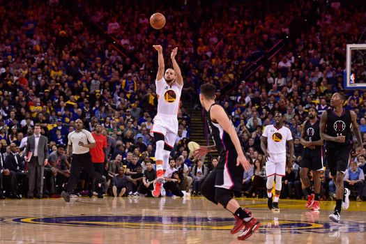 Golden State Warriors' Stephen Curry (30) shoots and makes a half-court shot in the final seconds of the second quarter of their game against the Los Angeles Clippers during their NBA game at the Oracle Arena in Oakland, Calif. on Saturday, Jan. 28, 2017. (Jose Carlos Fajardo/Bay Area News Group)