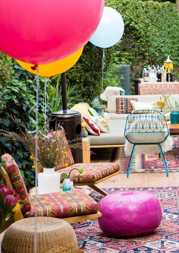 Style an outdoor space for a beautiful shower sprinkled with giant balloons since she's about to pop. Find out more at Emily Henderson.