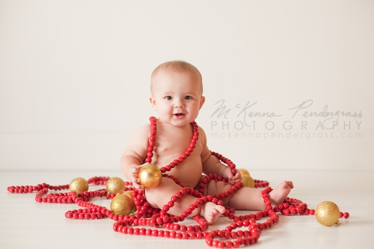 Baby Christmas Portrait.  Such a cute and safe alternative to using Christmas lights!  Photo by McKenna Pendergrass Photography