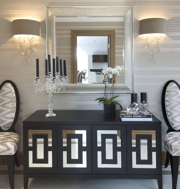 Entryway... maybe something like this? MIrrored buffet, big mirror and candles?