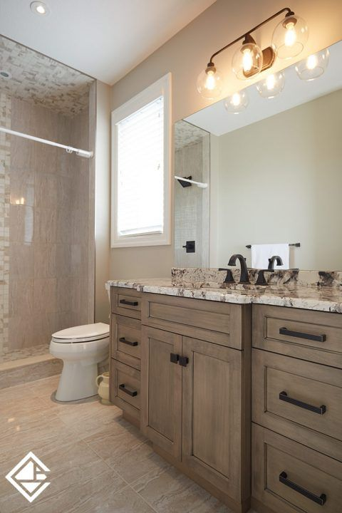 Gorgeous custom grey maple stained vanity with a single sink and