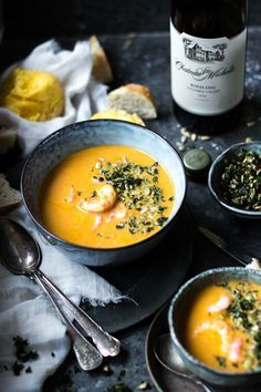 Comforting, warm, and rustic. This soup dish looks incredible and the bright color of the soup is a perfect contrast to the dark background. The props add great visual appeal, especially the wine and the spoons. It helps the photo to look as if it was spontaneously taken during a cozy dinner. This is a good example of food photography.