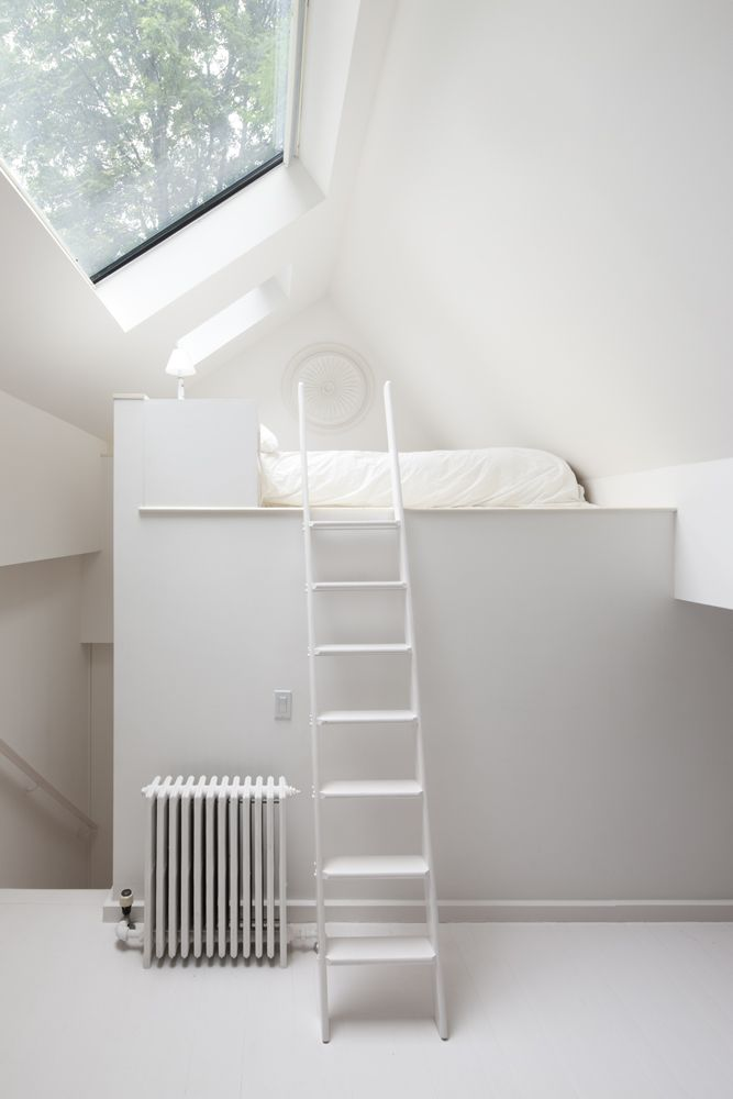 Really interesting way of dealing with lost floor space when we convert the loft - put the bed on a platform over the stairs...