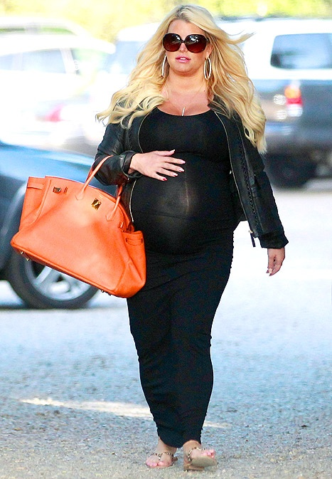 Pregnant Jessica Simpson exposes her big baby bump in a sheer black dress in Ojai, Calif. on May 26.