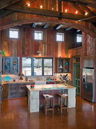 love the mix of barn wood rock and color in this kitchen