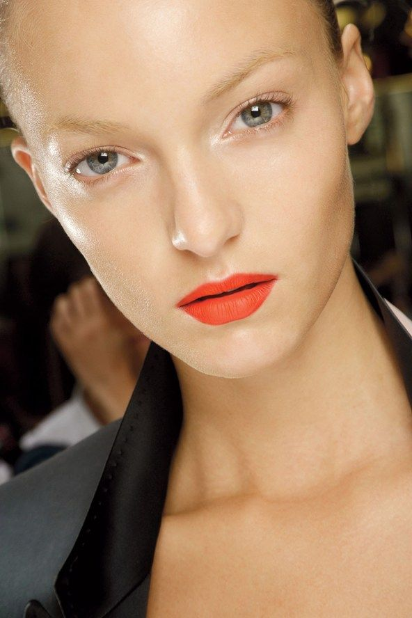 Paul Smith MAC's Lady Danger Lipstick was set with the brand's Neon Orange Pigment for bold, matte lips that stood out on the models' otherwise natural-looking faces